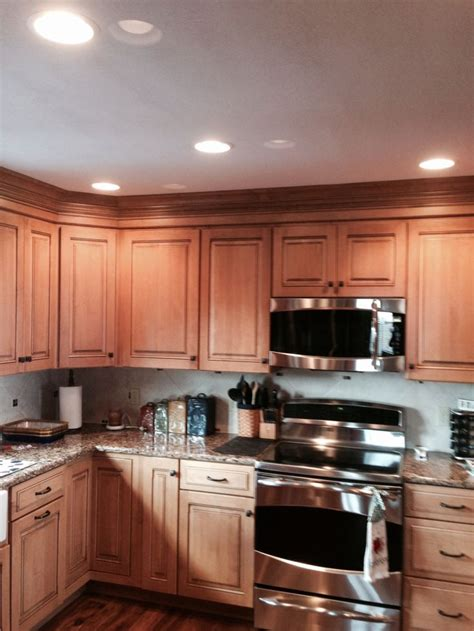maple cabinets  quartz countertops kitchen remodels
