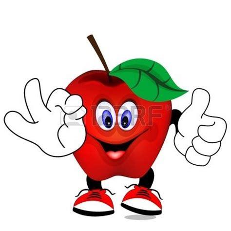 dibujo animado de manzana roja sonriendo y haciendo una señal con sus manos foto de archivo
