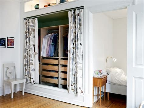 gray and turquoise bedroom how to disguise an open closet in a room interior