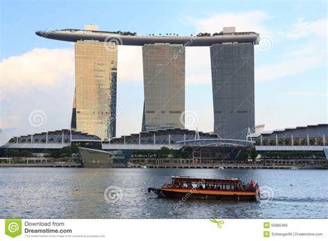 Boat At Marina Bay by Boat And Marina Bay Sands Hotel Singapore Editorial Image