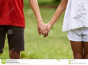 Children In Love, Boy And Girl Holding Hands Stock Photo ...