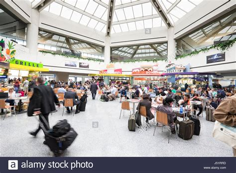 People Sitting At Tables Inside Food Court Terminal C