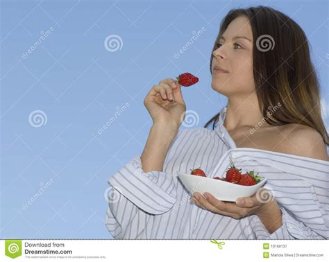 Pretty Girl Relaxing On Balcony And Eat Red Fresh Royalty
