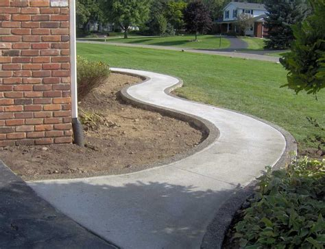 winding broom finish standard concrete walkway  exposed aggregate border  bloomfield hills