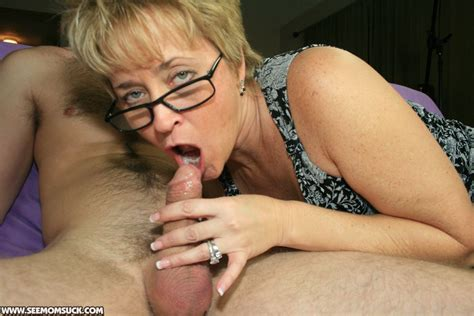 Short Haired Mature Blonde In Glasses Gives A Sensual