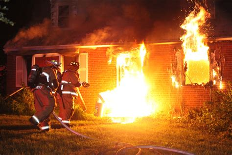 springfield township firefighters battle house fire