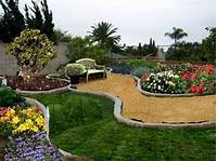 nice garden design patio ideas simple yet stylish. curved pathways with a mix of lawn, and flower beds. Nice stone for the ...