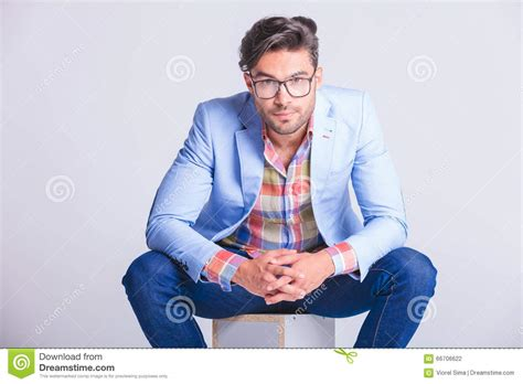 Attractive Businessman Seated With Legs Spread Open Stock