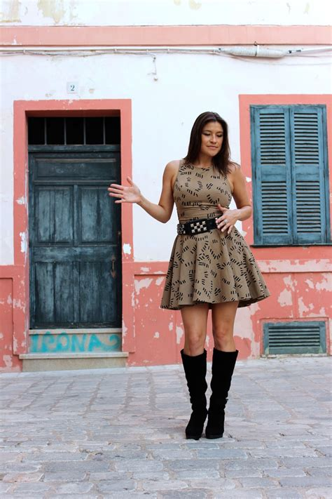 wear tall boots  dresses  style