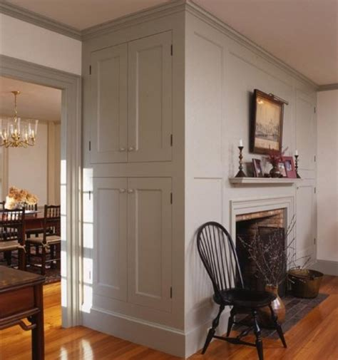 like built in cabinets on the end colonial fireplace with