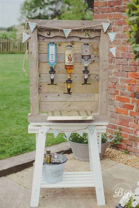 homemade outdoor bar to keep your wedding guests watered whilst they are enjoying the sunshine