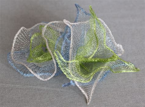 knitted copper wire forming flowers wireknitz millinery