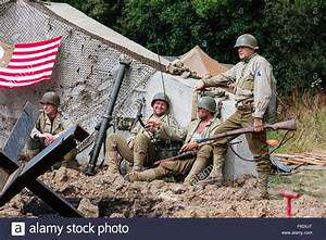 WW2 Re-enactment. Group of American soldiers sitting by ...