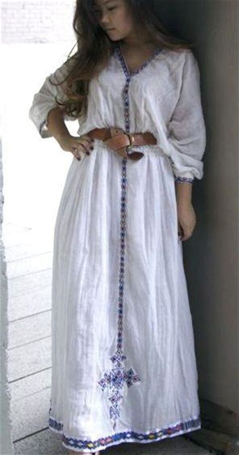 white long sleeved traditional ethiopian dress  blue