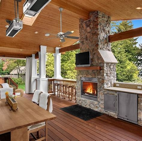 stone fireplace    outdoor kitchen   lovely