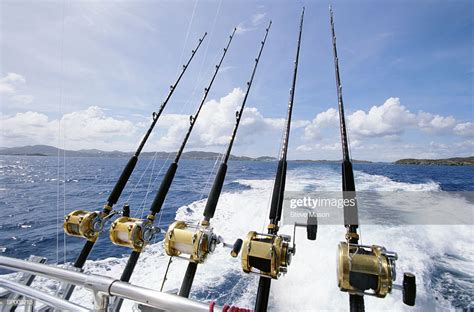 saltwater fishing rods affixed  boats stern stock photo