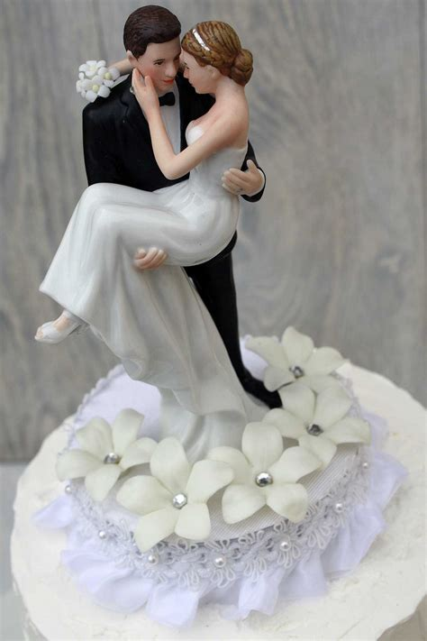 stephanotis groom holding the wedding cake topper wedding collectibles