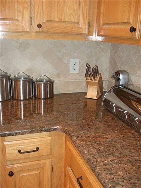 kitchen backsplash ideas for oak cabinets pin by on home ideas 9054