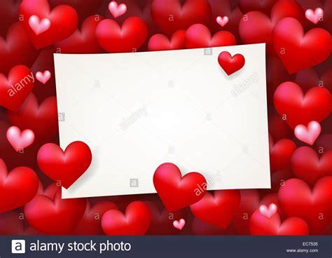 carte de papier vierge entouree de coeur rouge flottant