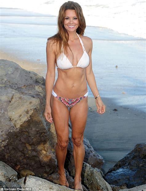 casey labow swimsuit brooke burke charvet displays her washboard stomach and