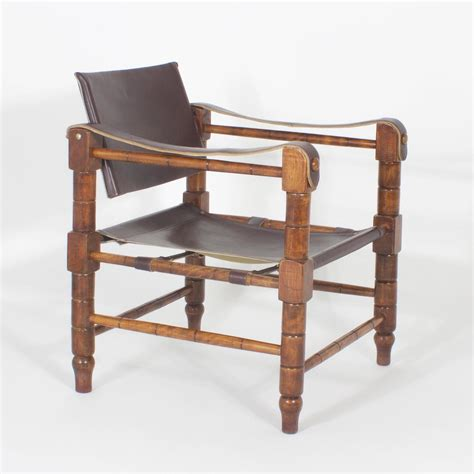 handsome pair of brown leather caign or safari chairs