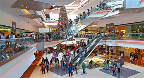 christmas shoppers  shopping mall editorial stock photo
