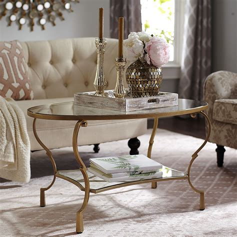 Check out our coffee table centerpiece selection for the very best in unique or custom, handmade pieces from our centerpieces & table décor shops. Chasca Glass Top Gold Oval Coffee Table | Oval glass coffee table, Oval coffee tables, Table ...