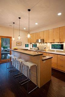 lighting for kitchen cabinets the contrast of and light slate floors and honey 9442