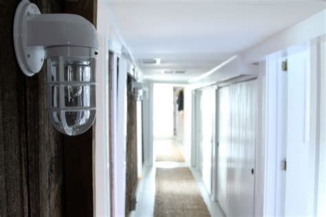rustic wall sconces line main hallway in converted dairy