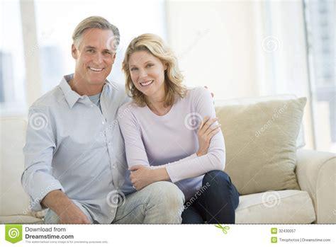 happy couple sitting  sofa  living room royalty