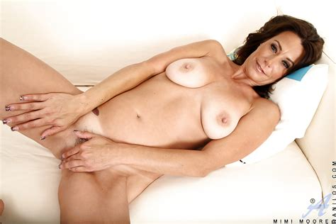 Fuckable Mature Brunette Getting Naked And Playing With