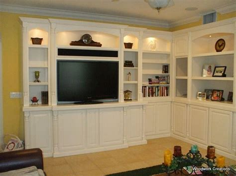 Custom, corner, built in wall unit in white lacquer   C