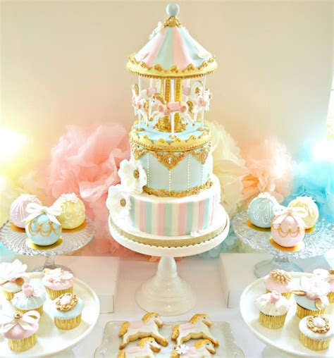 a pink gold carousel 1st birthday party party ideas pink blue and gold carousel cake table birthday