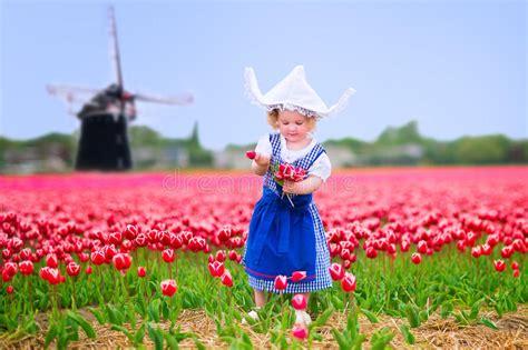 funny girl  dutch costume  tulips field  windmill