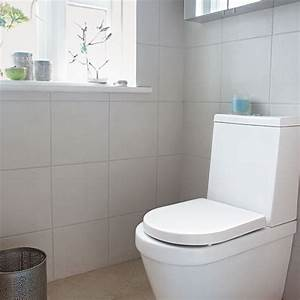 Budget decorating ideas for bathrooms ideas for home for Small bathroom big or small tiles
