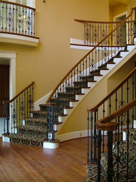 wood staircases  iron balusters