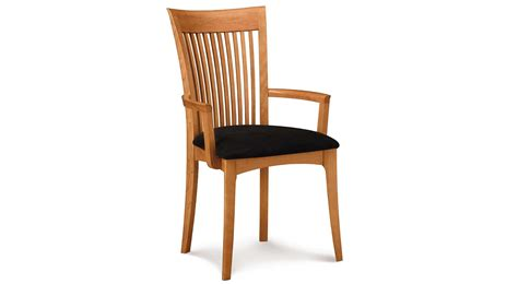 natura brown wooden chair with bars on the back plus arm