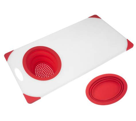 prepology over the sink cutting board with colander and
