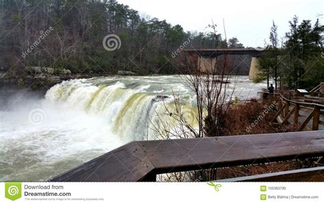 Powerful raging riverfall stock photo. Image of bridge - 105363790