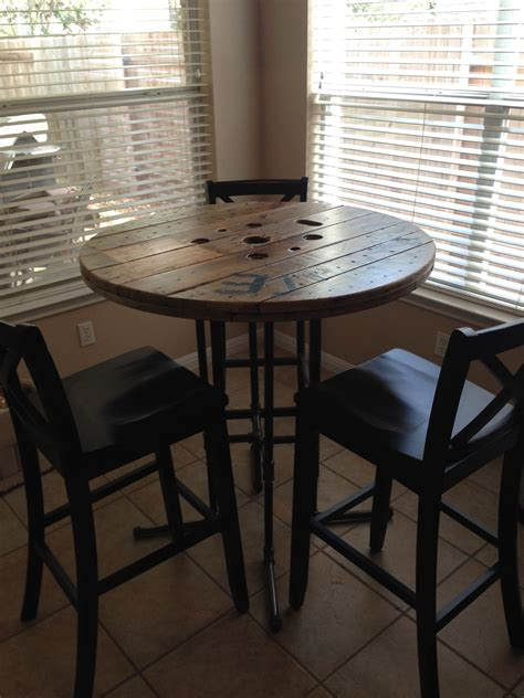 reclaimed wood spool breakfast bar height table