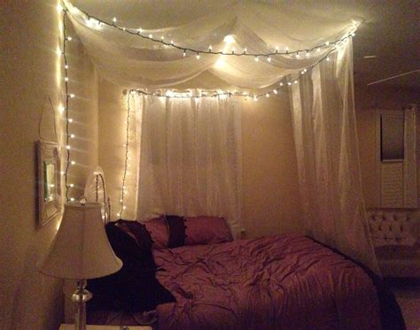 diy canopy bed  command strips sheer curtains