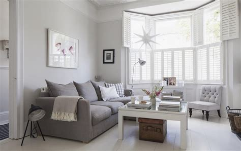 grey sofa white walls victorian terrace sitting room plantation shutters white wooden floors grey sofa light grey