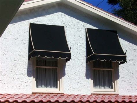 black fabric awning  house  white outlines fabric side awning spears outsideexteriors