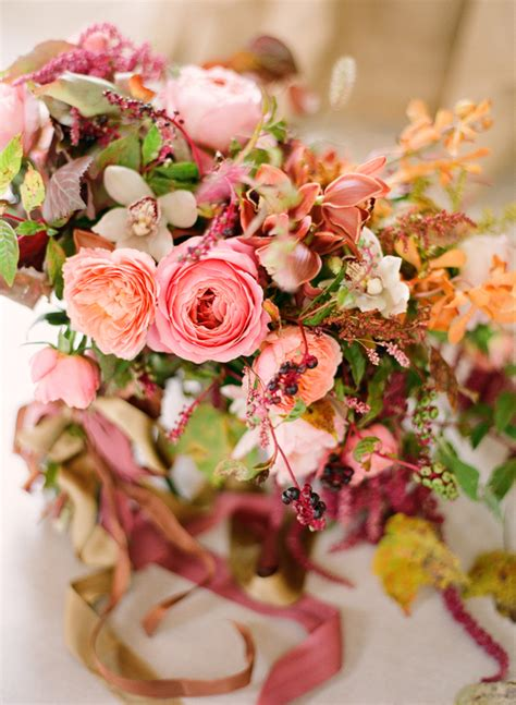 what to do when your orchid flowers fall fall wedding bouquet garden roses pink coral orange orchids mauve loose once wed