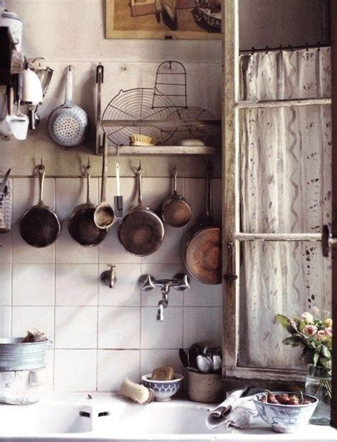 hang pots pans and kitchen tools from the wall or the ceiling for easy access