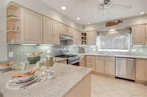 house kitchen with crema astoria granite countertops