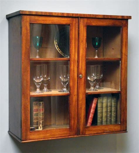 corner display with glass doors antique mahogany wall hanging antique wall