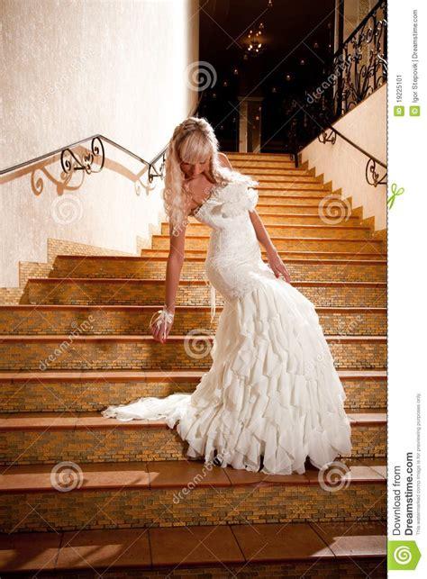 girl   wedding dress    stairs stock image