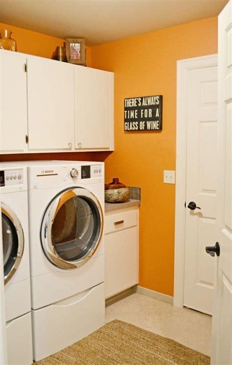 The Orange Wall Color Looks Amazing! Laundry Room Brock