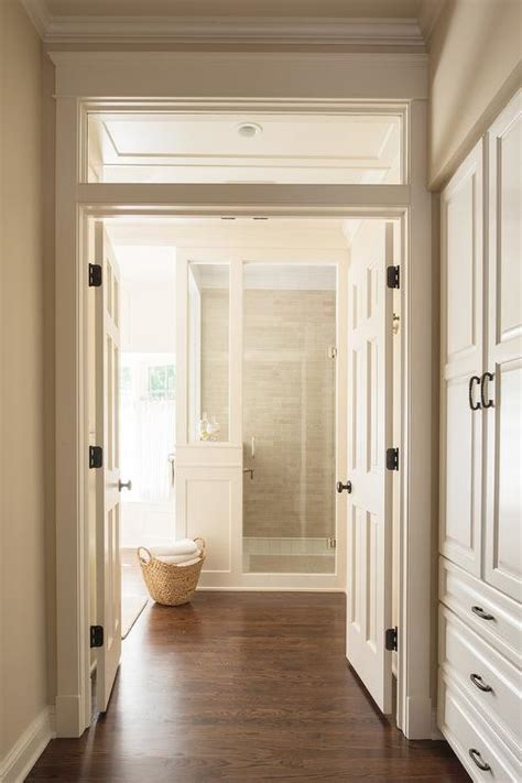 white master bathroom  dark wood trim transitional